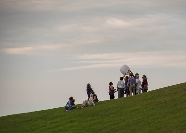 Close friends and family release a lantern atop  Kimberly Hill during a vigil type event on the one year anniversary of Thelma Krull's disappearance at Civic Park Monday July 11, 2016. (David Lipnowski for Metro News)