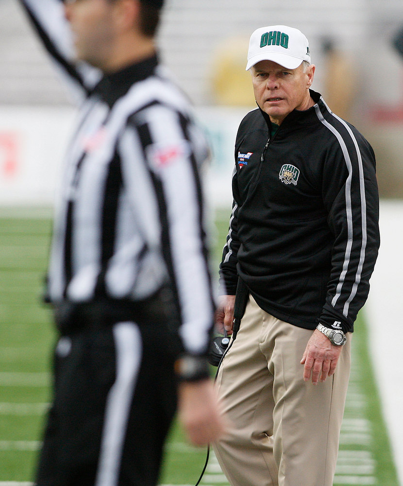 . Ohio head coach Frank Solich, right, takes issue with an official on what he considered a bad call during in the second quarter of the Independence Bowl NCAA college football game against Louisiana-Monroe in Shreveport, La., Friday, Dec. 28, 2012. (AP Photo/Charles A. Smith)