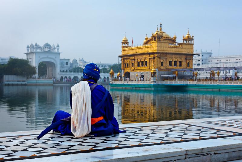 Unidentifiable Seekh Nihang warrior meditating at Sikh temple Harmandir Sahib