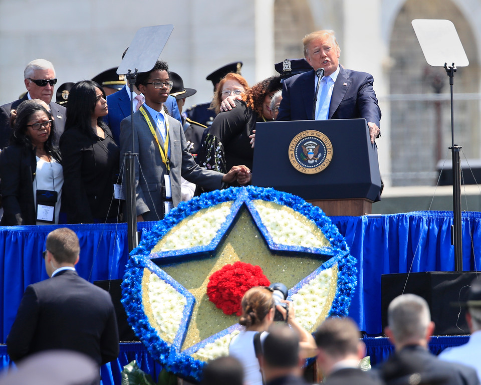 . President Donald Trump, joined by the family of New York Police Department detective Miosotis Familia, who was killed in the line of duty, speaks at the 37th Annual National Peace Officers\' Memorial Service on Capitol Hill in Washington, Tuesday, May 15, 2018. (AP Photo/Manuel Balce Ceneta)