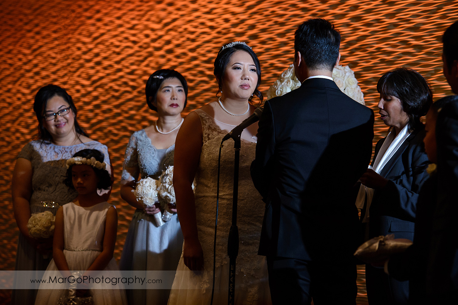 bride during the ceremony at Hilton San Francisco Airport Bayfront in Burlingame