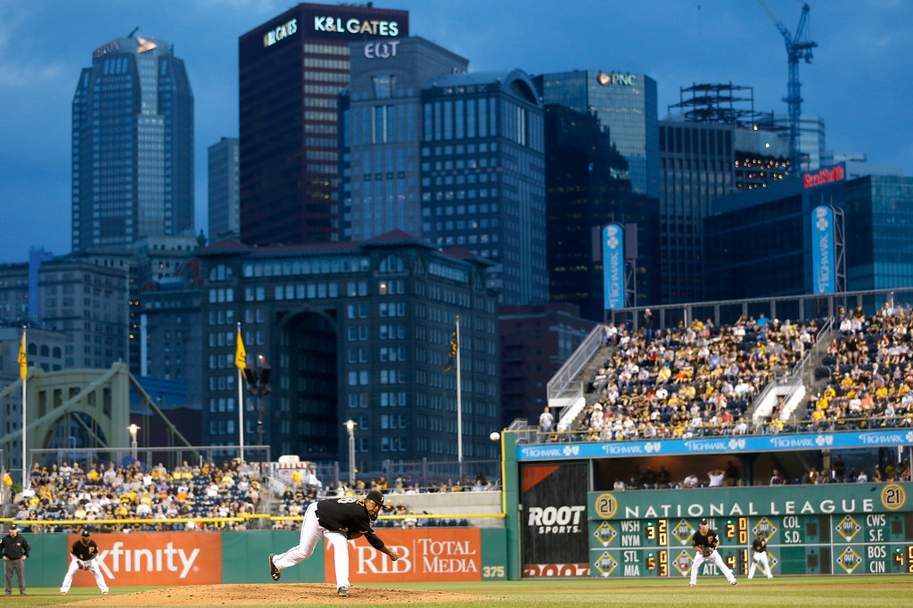 . The city skyline is seen behind PNC Park as Pittsburgh Pirates starting pitcher Edinson Volquez, center, throws against the Detroit Tigers in the fourth inning of the baseball game on Tuesday, Aug. 12, 2014, in Pittsburgh. (AP Photo/Keith Srakocic)