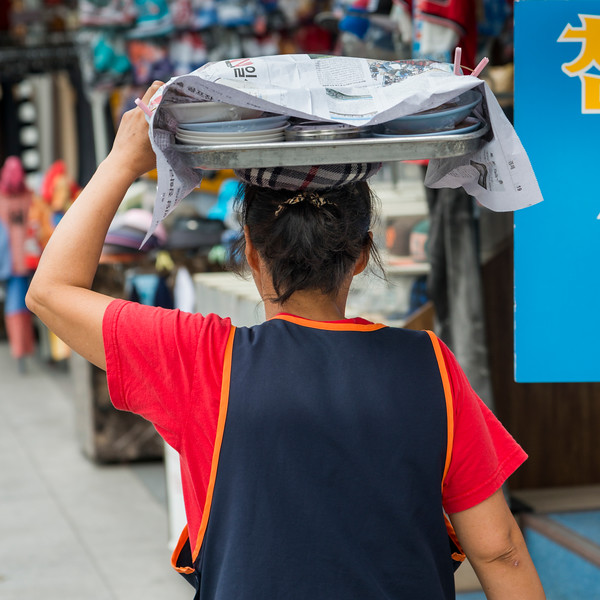 Woman carrying food on her head, Seoul, south Korea