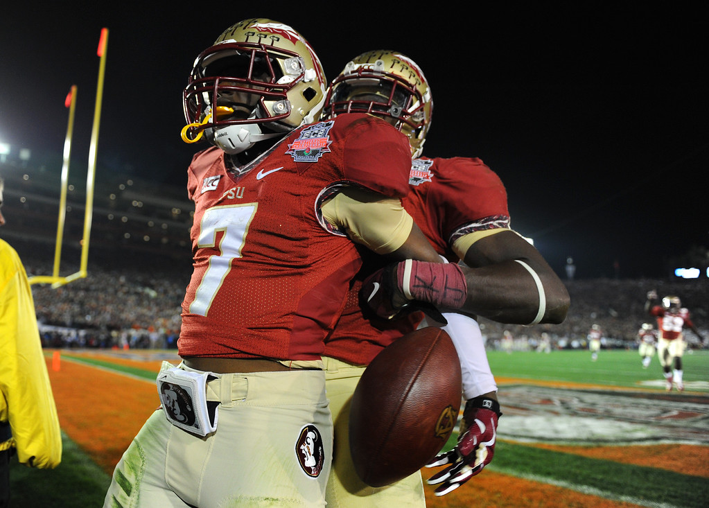 ". Florida State\'s Levonte Whitfield, left, tells Auburn fans ""it\'s over\"" after his kick return for a touchdown in the fourth quarter against Auburn the BCS national championship game at the Rose Bowl, Monday, January 6, 2014. (Photo by Michael Owen Baker/L.A. Daily News)"