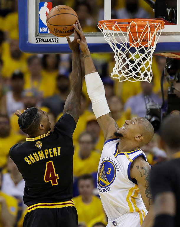 . Golden State Warriors forward David West (3) defends a shot by Cleveland Cavaliers guard Iman Shumpert (4) during the first half of Game 2 of basketball\'s NBA Finals in Oakland, Calif., Sunday, June 4, 2017. (AP Photo/Marcio Jose Sanchez)