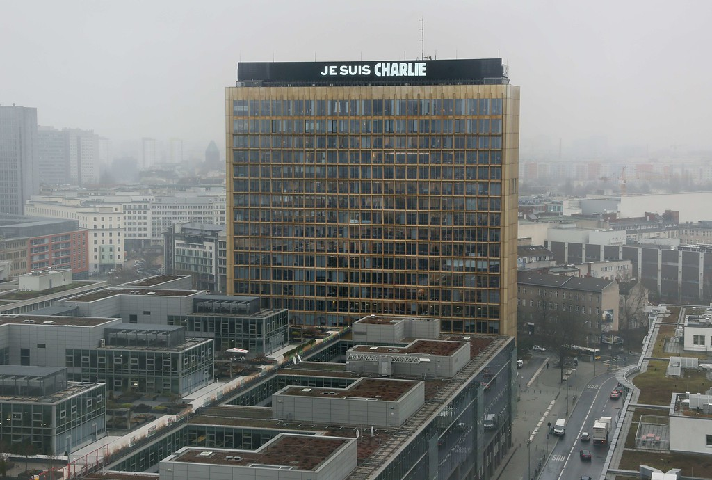 ". The lettering ""Je suis Charlie\"" (I am Charlie) is displayed on the roof of the German Axel Springer publishing group headquarters in Berlin on January 8, 2015 in commemoration of the victims of an attack by armed gunmen on the offices of French satirical newspaper Charlie Hebdo in Paris on January 7 which left at least 12 dead and many others injured. AFP PHOTO / DPA / STEPHANIE PILICK/AFP/Getty Images"
