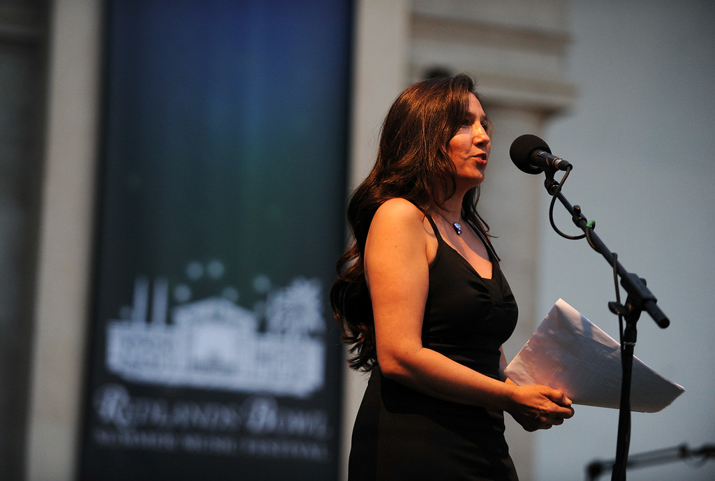 . Mistress of Ceremonies, Toni Momberger, speaks at the Redlands Bowl on Tuesday, July 15, 2014 in Redlands, Ca. (Micah Escamilla/Redlands Daily Facts)