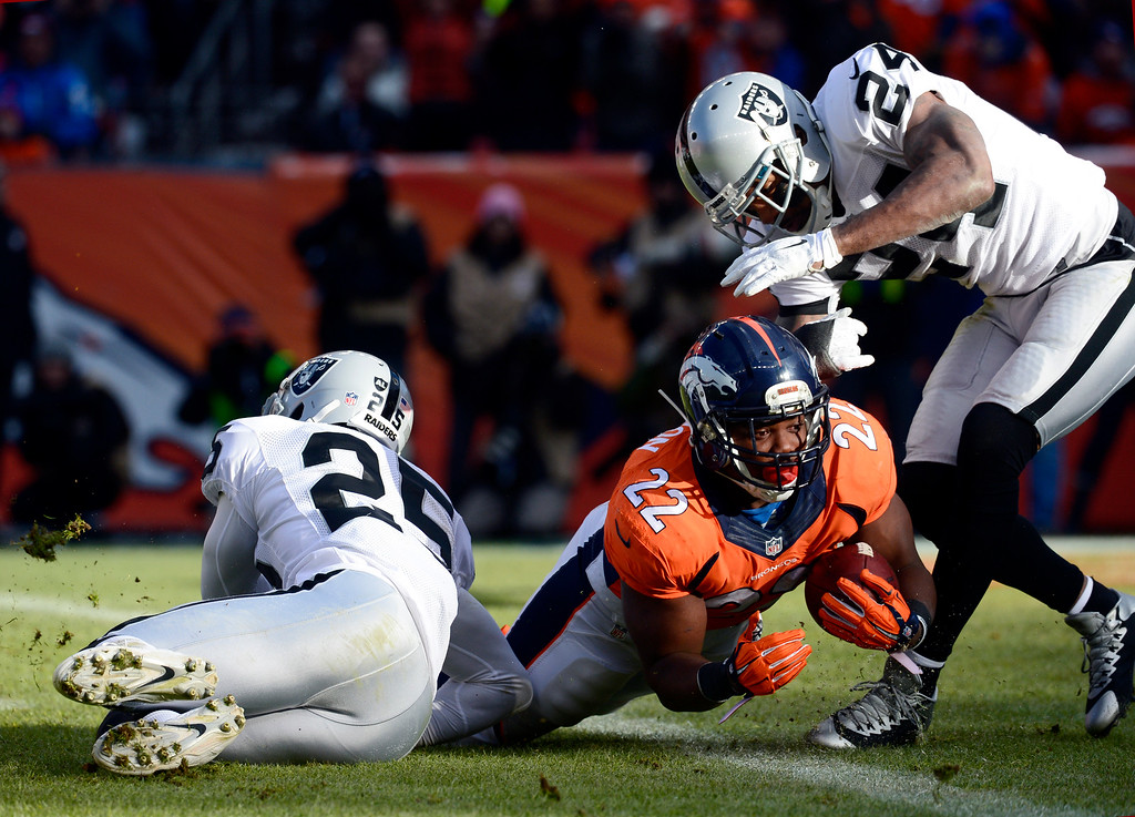 . DENVER, CO - DECEMBER 28: C.J. Anderson (22) of the Denver Broncos scores Denver\'s first touchdown of the game in the first quarter.  The Denver Broncos played the Oakland Raiders at Sports Authority Field at Mile High in Denver on December, 28 2014. (Photo by Tim Rasmussen/The Denver Post)