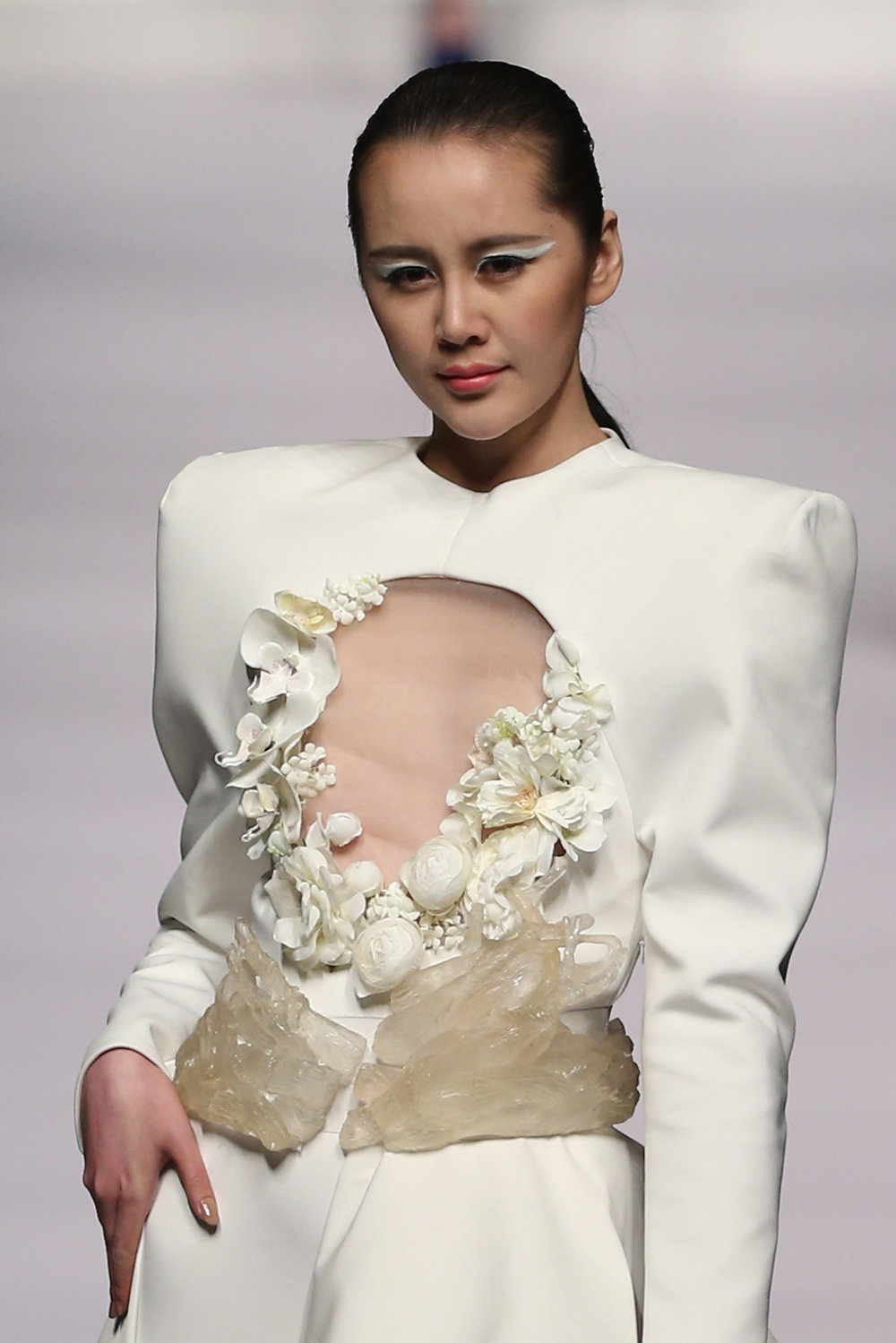 . A model showcases designs on the catwalk during Hempel Award the 21st China International Young Fashion Designers Contest  on the second day of Mercedes-Benz China Fashion Week Autumn/Winter 2013/2014  at Banquet Hall of Beijing Hotel on March 25, 2013 in Beijing, China.  (Photo by Feng Li/Getty Images)