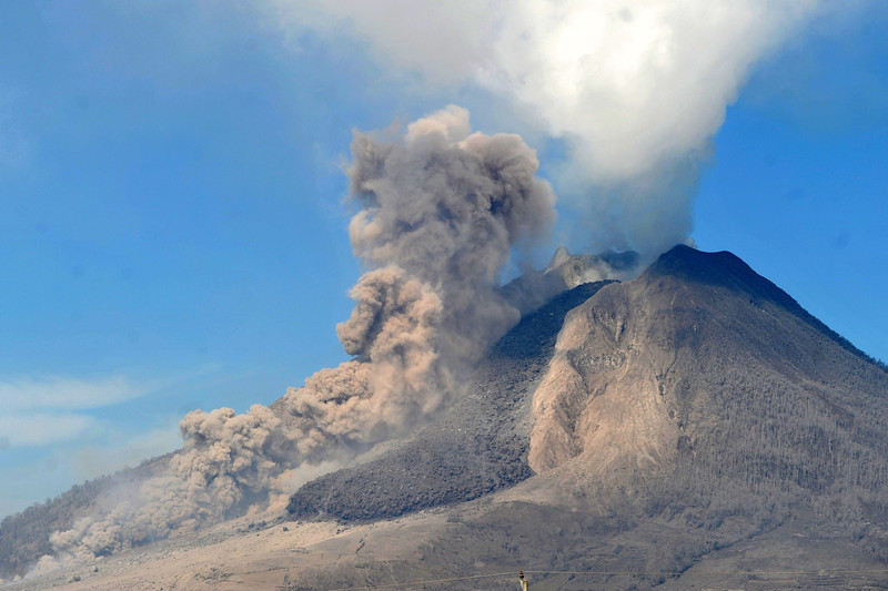 . Mount Sinabung volcano spews thick smoke and hot ash in Karo on February 4 , 2014. A volcano in western Indonesia that killed 15 people in a weekend eruption shot hot ash and rocks high into the air again on February 3, halting a search for any more victims. (ADEK BERRY/AFP/Getty Images)
