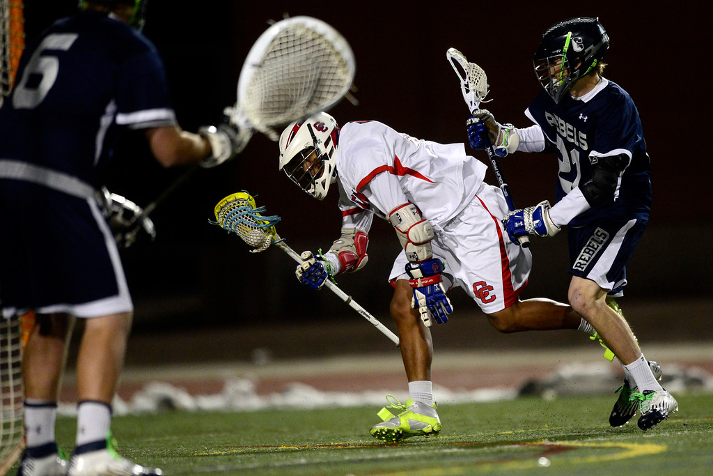 . Cherry Creek\'s Brandon Willis loses his footing as Columbine\'s Jake Allen defends during Cherry Creek\'s 7-6 win.  (Photo by AAron Ontiveroz/The Denver Post)