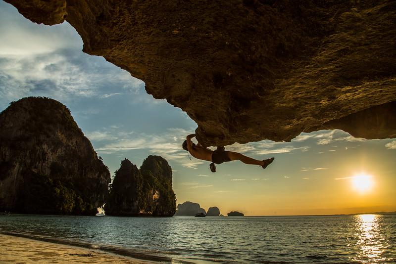 Casey Franklin climbs unknow boulder route, Pra Nang Beach, Krabi, Thailand.