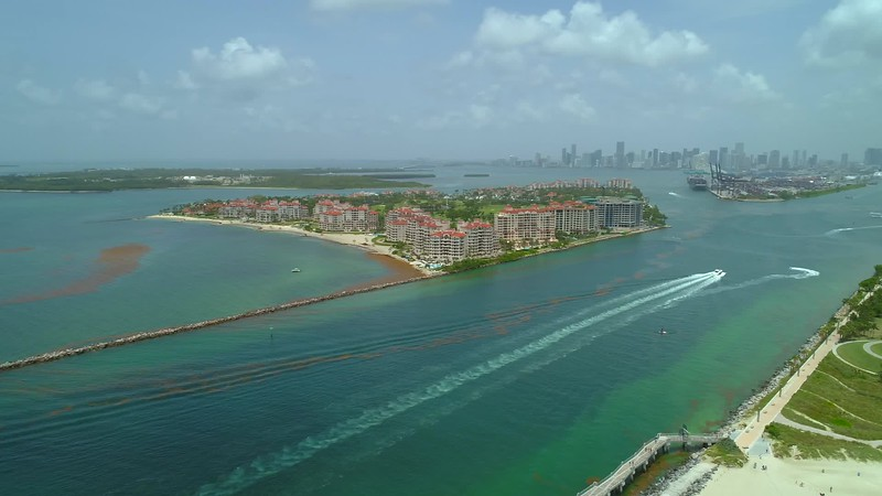 Aerial panning video Miami Beach South Pointe and inlet port 4k 24p