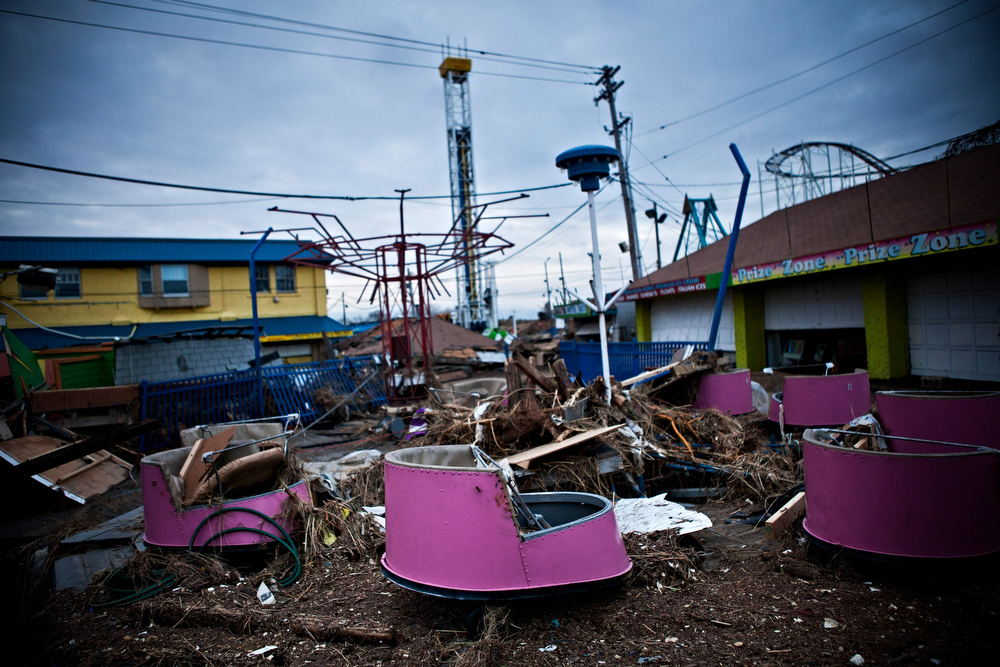 Description of . Damaged rides and debris are strewn across the Keansburg Amusement Park after Superstorm Sandy swept across the region, on November 1, 2012 in Keansburg, New Jersey. Superstorm Sandy, which has left millions without power or water, continues to effect business and daily life throughout much of the eastern seaboard.  (Photo by Andrew Burton/Getty Images)