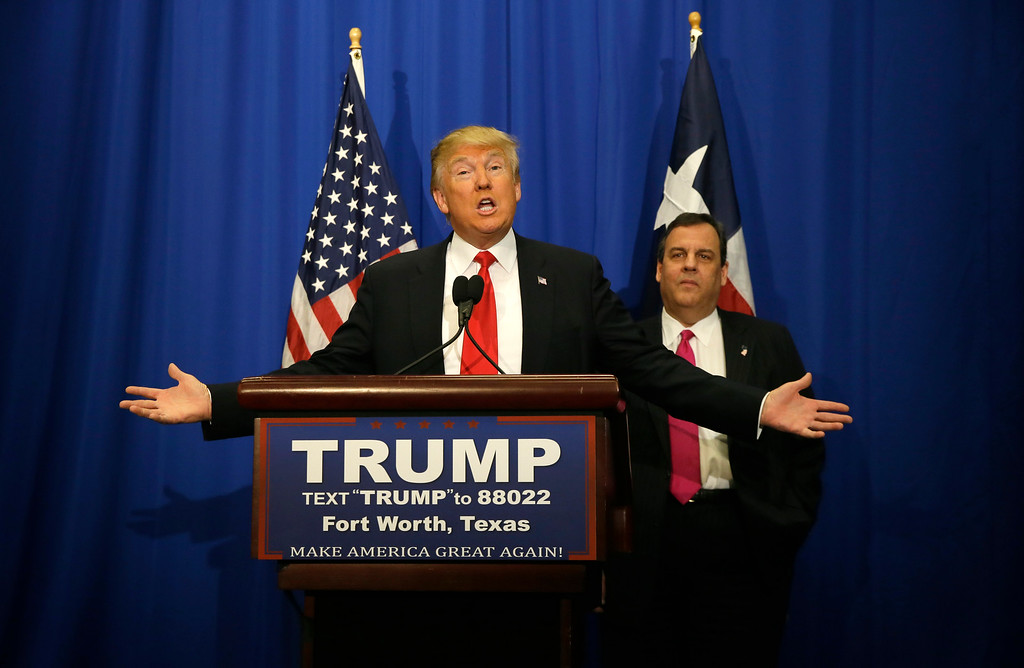 . Republican presidential candidate Donald Trump, accompanied by New Jersey Gov. Chris Christie, speaks before a rally in Fort Worth, Texas, Friday, Feb. 26, 2016. (AP Photo/LM Otero)