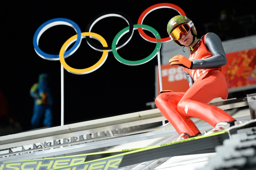 . Poland\'s Kamil Stoch prepares near the Olympic Rings before his Men\'s Ski Jumping Large Hill second Official training jump at the RusSki Gorki Jumping Center during the Sochi Winter Olympics on February 13, 2014 in Rosa Khutor near Sochi .AFP PHOTO / PETER PARKS/AFP/Getty Images