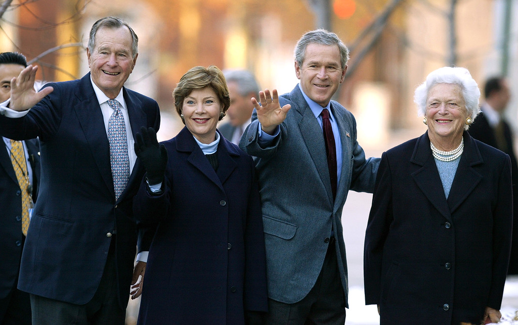 . Former President George H.W. Bush, first lady Laura Bush, President Bush, and former first lady Barbara Bush wave to reporters outside St. John\'s church on Sunday, Dec. 7, 2003 in Washington.  (AP Photo/Evan Vucci)