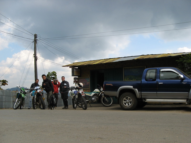In front of Sa-ngiam's house waiting for the group on the first day of riding