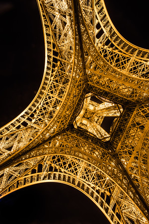 Underneath the Eiffel Tower at night, Paris, France