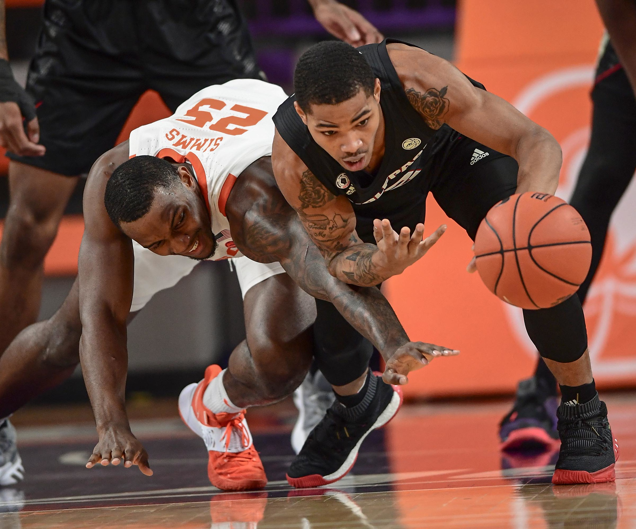 Clemson senior forward Aamir Simms(25) and NC State guard Shakeel Moore(2) reach for a loose ball during the first half Jan 5, 2021; Clemson, South Carolina, USA;  at Littlejohn Coliseum. Mandatory Credit: Ken Ruinard-USA TODAY Sports