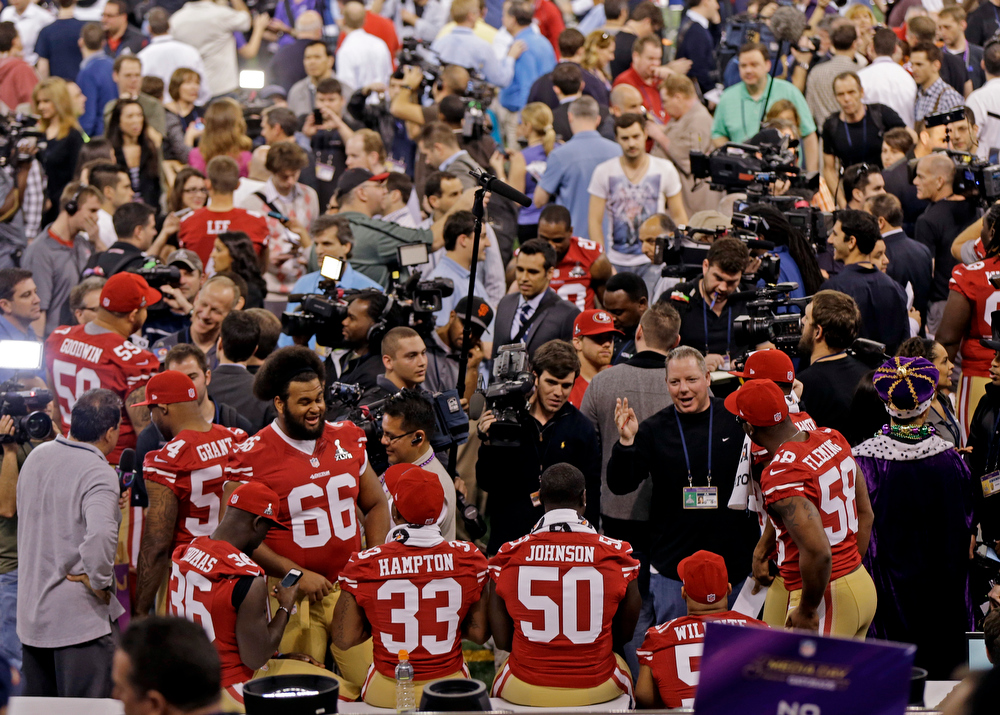 Description of . San Francisco 49ers players are interviewed during media day for the NFL Super Bowl XLVII football game Tuesday, Jan. 29, 2013, in New Orleans. (AP Photo/Gerald Herbert)