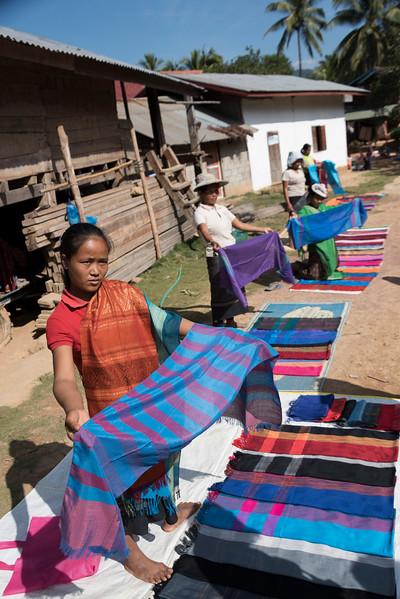 Women selling shawls in village, Sainyabuli Province, Laos