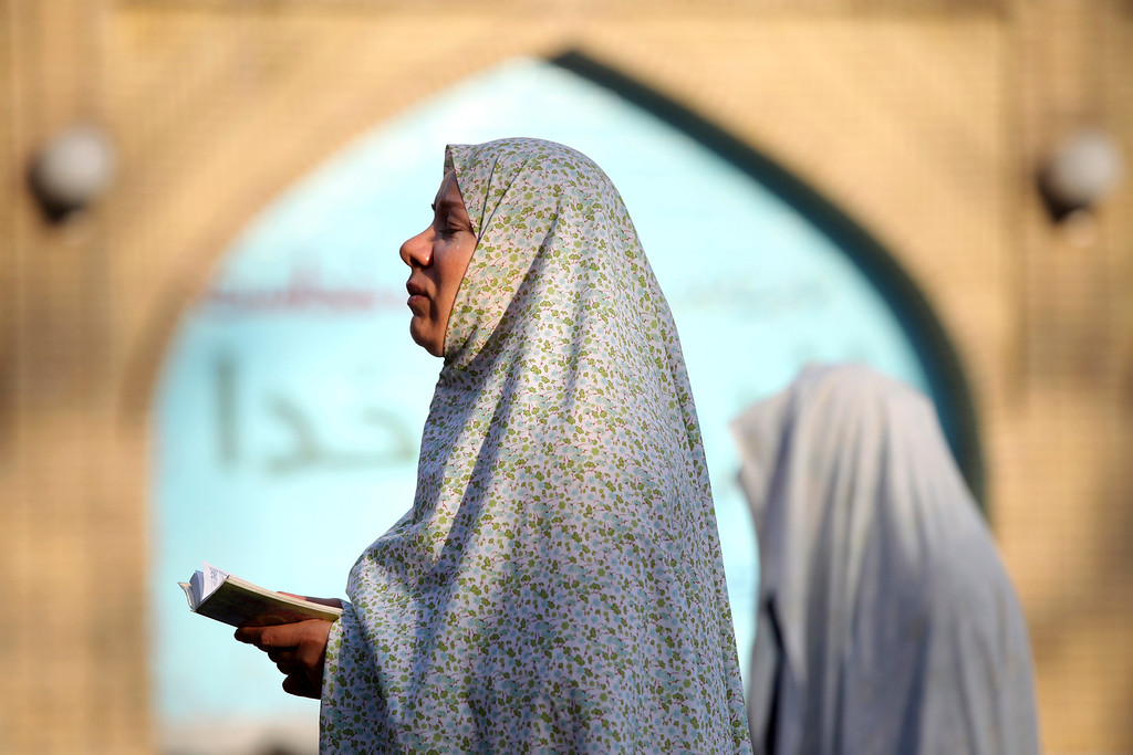 . An Iranian woman prays as she attends the Eid al-Fitr prayer in Tehran, Iran, Friday, Aug. 9, 2013. The Eid al-Fitr celebration marks the end of the holy month of Ramadan, during which Muslims all over the world fast from sunrise to sunset. (AP Photo/Ebrahim Noroozi)