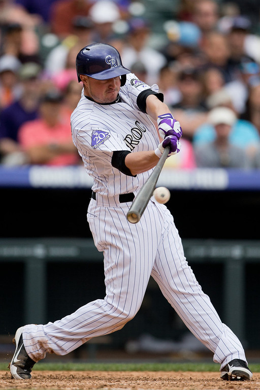 . Jordan Pacheco #15 of the Colorado Rockies hits an RBI single during the fifth inning against the San Francisco Giants at Coors Field on May 19, 2013 in Denver, Colorado. The Rockies defeated the Giants 5-0. (Photo by Justin Edmonds/Getty Images)