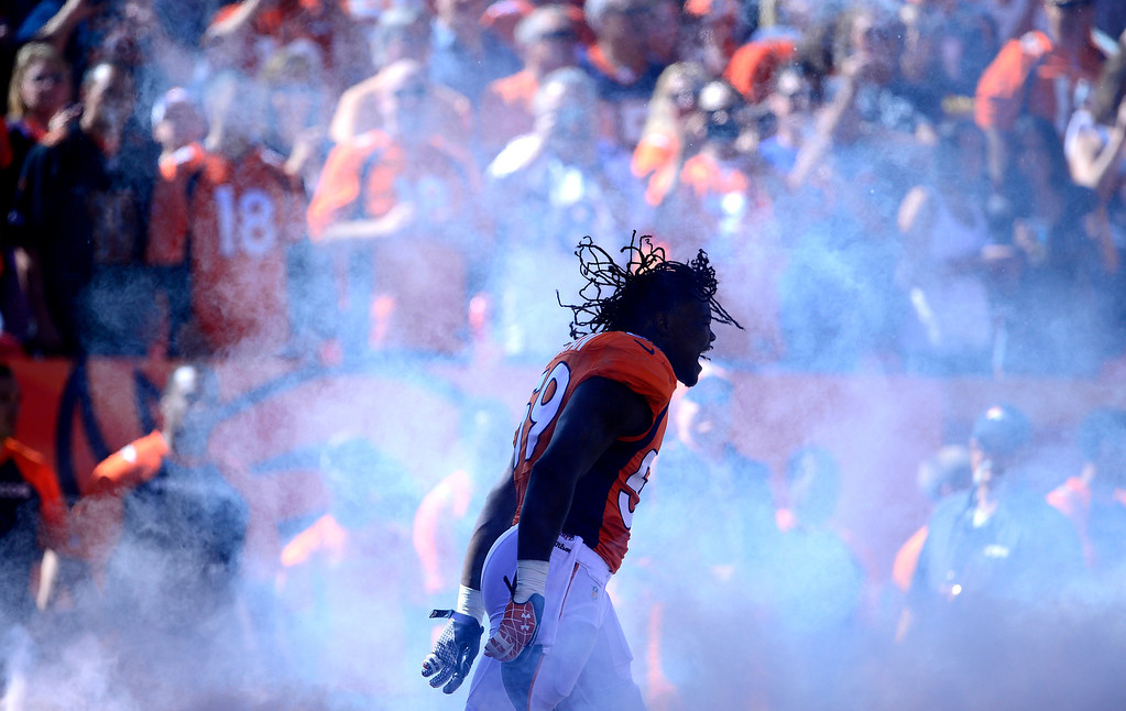 . Denver Broncos linebacker Danny Trevathan (59) runs through smoke to take the field.  (Photo by AAron Ontiveroz/The Denver Post)