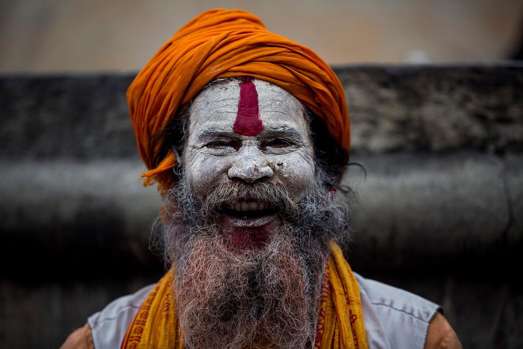 . A Sadhu (holy man) laughs at the Pashupati Temple in Kathmandu, Nepal, 27 February 2014, to mark the biggest Hindu festival Maha Shivaratri.   EPA/NARENDRA SHRESTHA