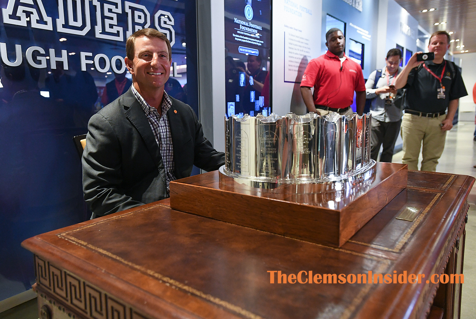 Clemson head coach Dabo Swinney sits at Gen. Douglas MacArthur's desk after accepting the NFF MacArthur Bowl, the organization's national championship trophy for the NCAA Division I - Football Bowl Subdivision, during a ceremony at the Chick-fil-A College Football Hall of Fame in Atlanta Wednesday, April 24, 2019. Bart Boatwright/The Clemson Insider
