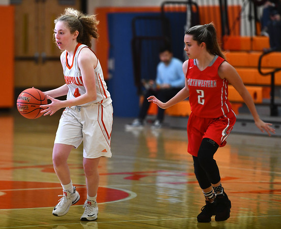 12/26/2019 Mike Orazzi | StaffrTerryville High School's Zoe Zappone (4) along with Northwestern's Francesca DeSanti (2) during Thursday's girls basketball game in Terryville.