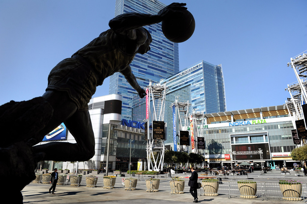 . A statue of Magic Johnson at Staples Center looking towards L.A. Live, Wednesday, October 26, 2011.(Michael Owen Baker/Staff Photographer)