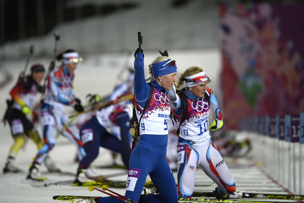 . (From 2dR) Finland\'s Kaisa Makarainen and Czech Republic\'s Gabriela Soukalova arrive at the shooting range as they compete in the Women\'s Biathlon 12,5 km Mass Start at the Laura Cross-Country Ski and Biathlon Center during the Sochi Winter Olympics on February 17, 2014, in Rosa Kuthor, near Sochi.  AFP PHOTO / PIERRE-PHILIPPE MARCOU/AFP/Getty Images