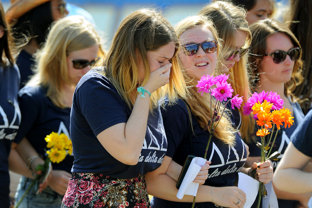 . Members of the UCSB Delta Delta Delta sorority enter a memorial service at Harder Stadium at UCSB for the victims of Friday\'s Isla Vista rampage, Tuesday, May 27, 2014. (Photo by Michael Owen Baker/Los Angeles Daily News)