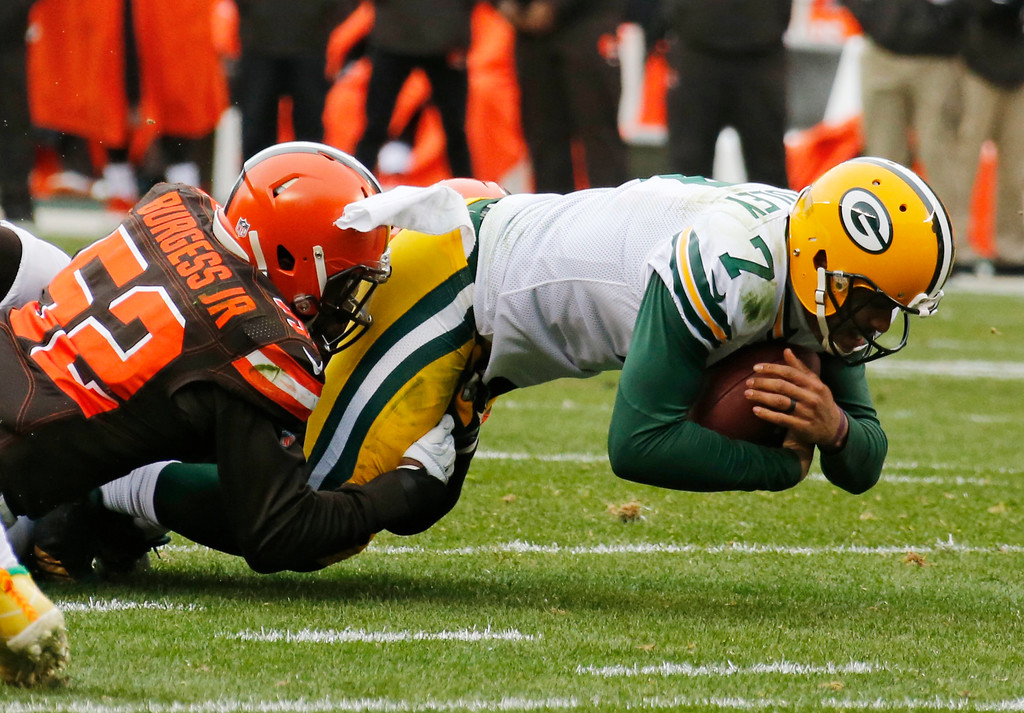. Green Bay Packers quarterback Brett Hundley (7) is tackled by Cleveland Browns inside linebacker James Burgess (52) on a 4th down for a loss in the second half of an NFL football game, Sunday, Dec. 10, 2017, in Cleveland. (AP Photo/Ron Schwane)