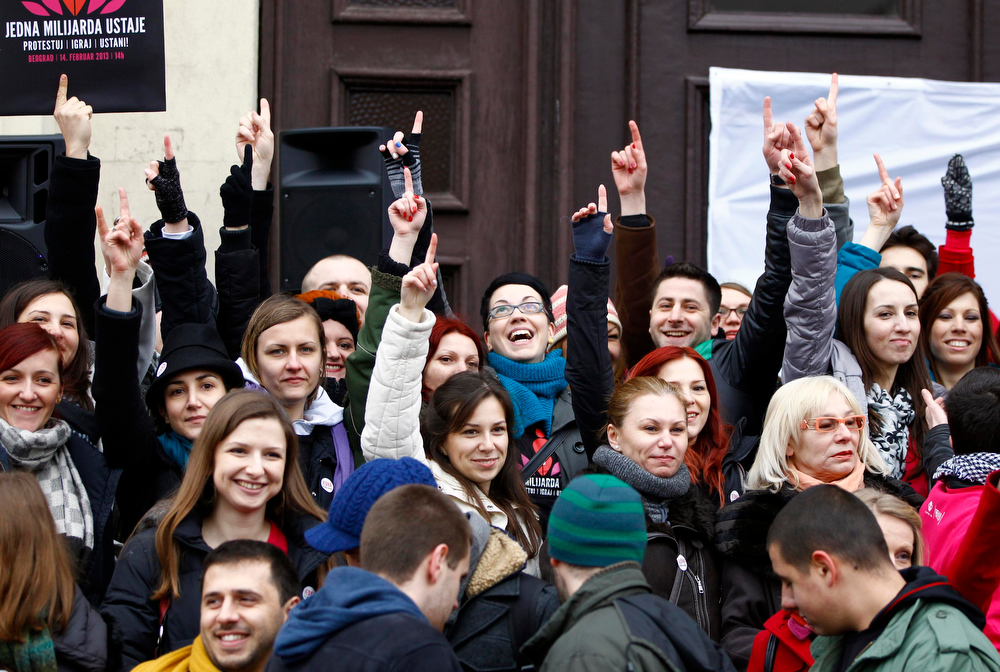 Description of . People raise their fingers to the air at a gathering of the 'One Billion Rising' campaign in Belgrade February 14, 2013. 'One Billion Rising' is a campaign to call for the end of violence against women, according to the organisers. REUTERS/Marko Djurica