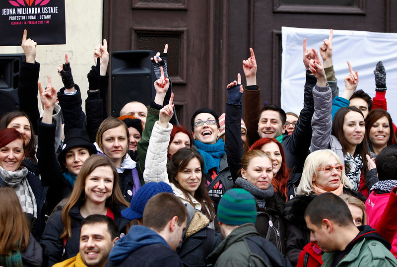 . People raise their fingers to the air at a gathering of the \'One Billion Rising\' campaign in Belgrade February 14, 2013. \'One Billion Rising\' is a campaign to call for the end of violence against women, according to the organisers. REUTERS/Marko Djurica