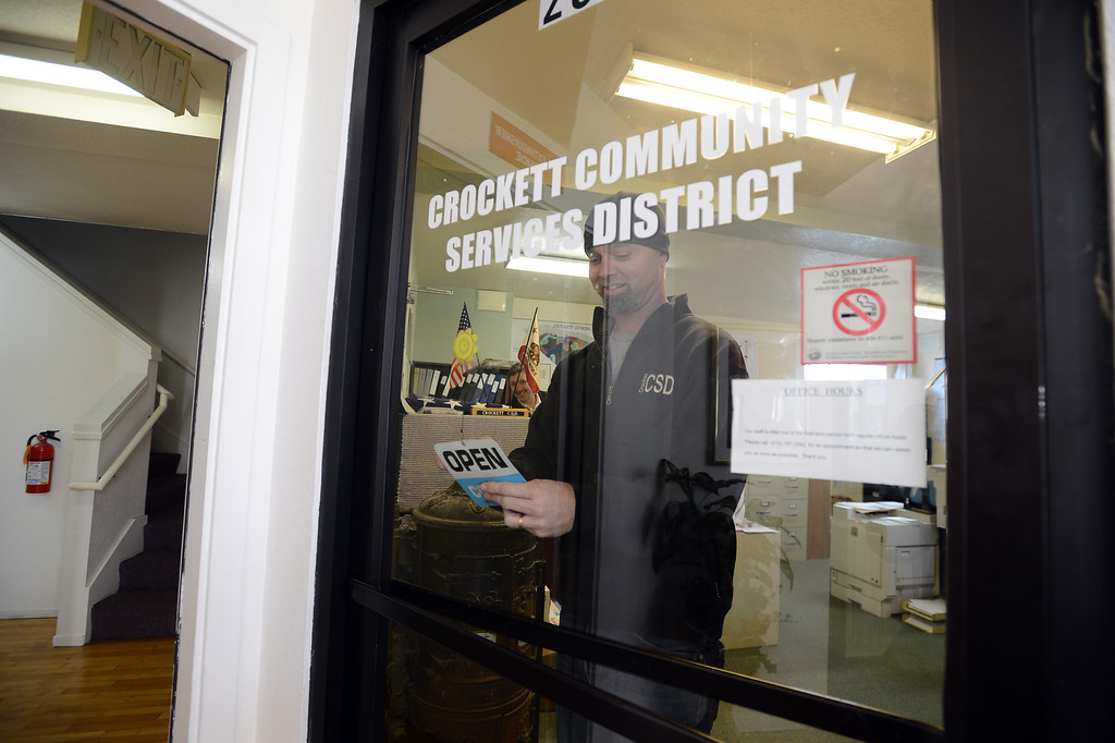 . Crockett Community Services District General Manager Dale McDonald closes up the office as he leaves to lead a walking tour of the town in Crockett, Calif. on Tuesday, Jan. 15, 2013. The Town of Crockett in Contra Costa County is the first government entity to release 2012 compensation in BANG\'s annual collection of government spending. (Kristopher Skinner/Staff)