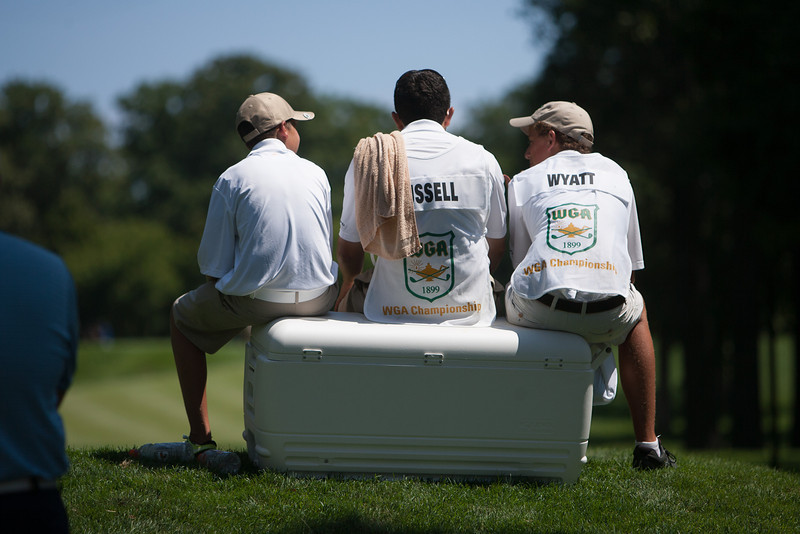 Caddies relax on a water cooler as they wait for the 8th green to clear during first round medal play at the 2012 Western Amateur Championship at Exmoor Country Club in Highland Park IL. on Tuesday, July 31, 2012. (WGA Photo/Charles Cherney)