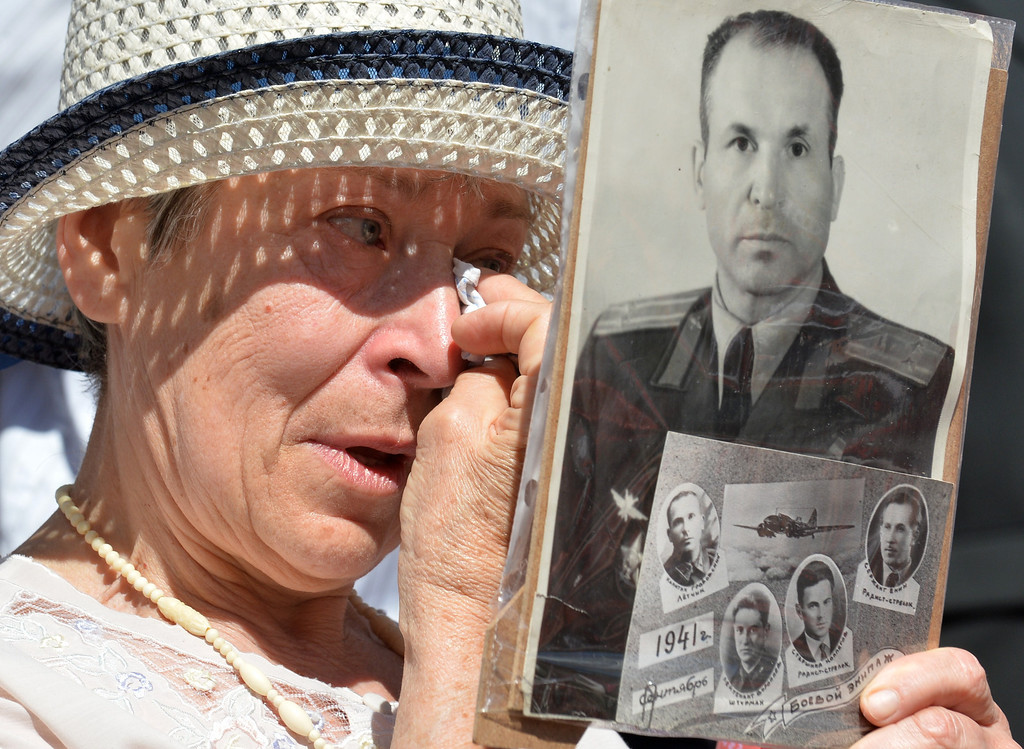 . A woman cries as she holds up a picture of a relative during a march in the center of Kiev to celebrate Victory Day on May 9, 2013. Ukraine, Russia and other countries of the former Soviet Union  celebrate today the victory over Nazi Germany during World War II. SERGEI SUPINSKY/AFP/Getty Images