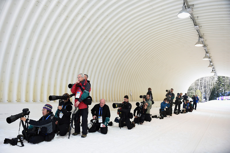 . Photographers line up for the Women\'s 10 km Classic during day six of the Sochi 2014 Winter Olympics at Laura Cross-country Ski & Biathlon Center on February 13, 2014 in Sochi, Russia.  (Photo by Harry How/Getty Images)