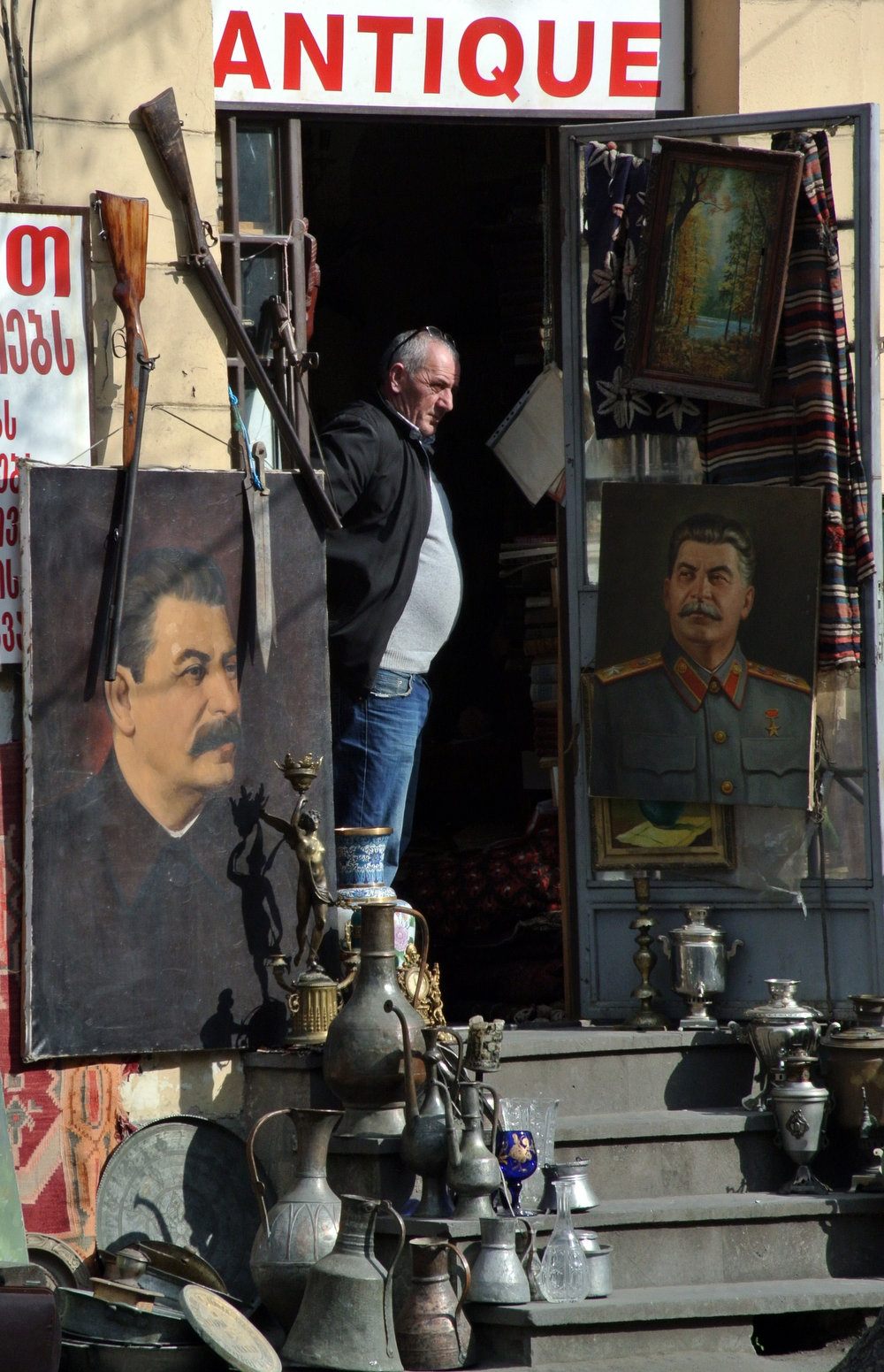 . A vendor stands at the entrance of his antique shop offering portraits of Joseph Stalin on February 18, 2013 in central Tbilisi some 50 miles from Stalin\'s hometown. VANO SHLAMOV/AFP/Getty Images