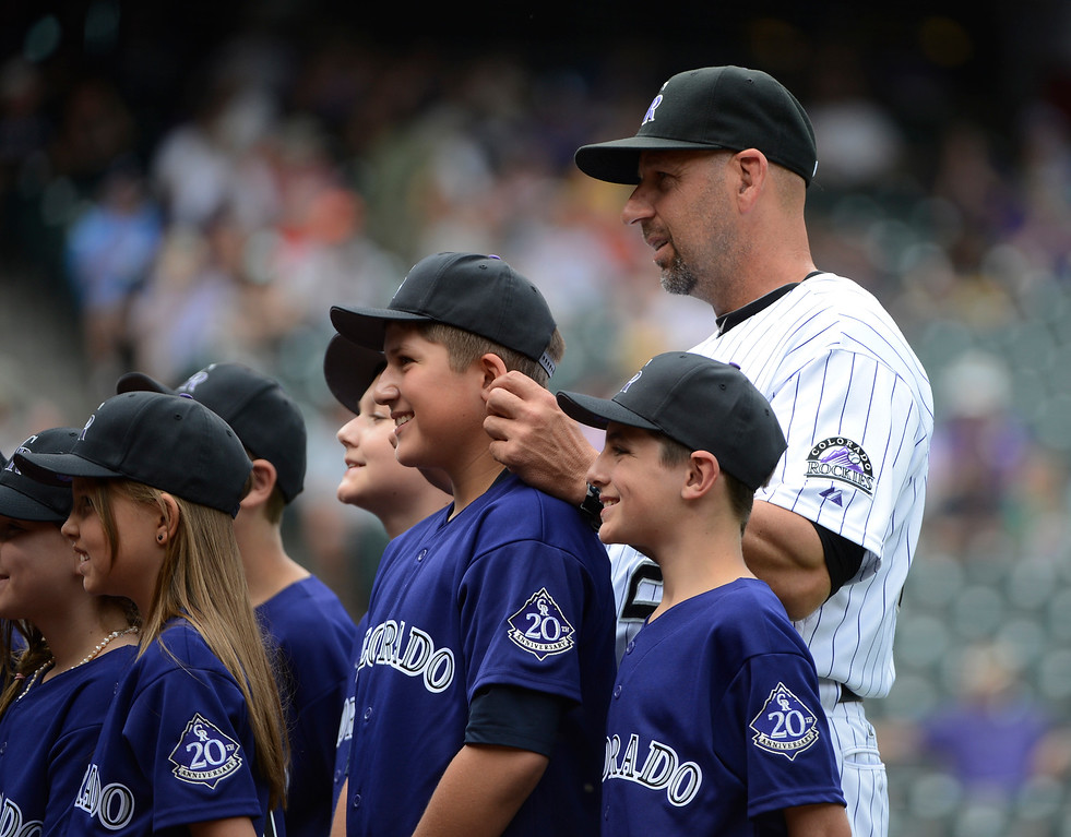 . DENVER, CO - JUNE 27: Colorado Rockies manager, Walt Weiss pulls the ears of one of the honorary ball kids before the game against the San Francisco Giants at Coors Field Saturday afternoon, June 29, 2013. (Photo By Andy Cross/The Denver Post)