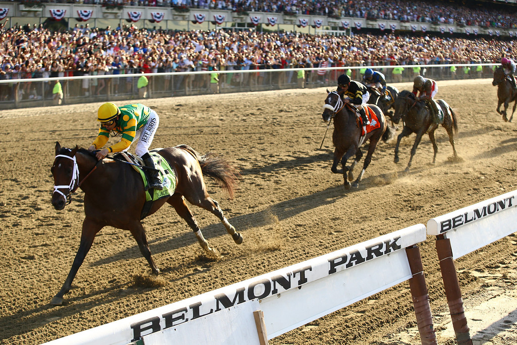 . Palace Malice ridden by Mike Smith wins the 145th running of the Belmont Stakes followed by Oxbow and orb at Belmont Park on June 8, 2013 in Elmont, New York.  (Photo by Al Bello/Getty Images)
