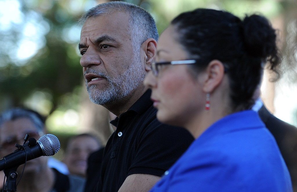 . City of South Gate mayor, Gil Hurtado, left, with assembly member Cristina Garcia (D-Bell Gardens) speaks during a press conference calling for Senator Ron Calderon to resign his position in the California State Senate in front of the Bell Gardens City Hall in Bell Gardens , Calif., on Wednesday, Nov. 13, 2013.   (Keith Birmingham Pasadena Star-News)