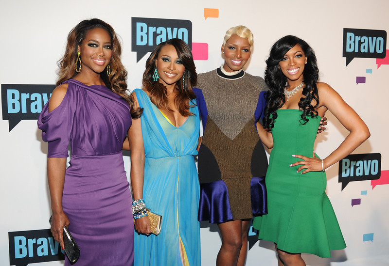 ". ""The Real Housewives of Atlanta\"" cast members, from left, Kenya Moore, Cynthia Bailey, NeNe Leakes and Porsha Stewart attend the Bravo Network 2013 Upfront on Wednesday April 3, 2013 in New York. (Photo by Evan Agostini/Invision/AP)"