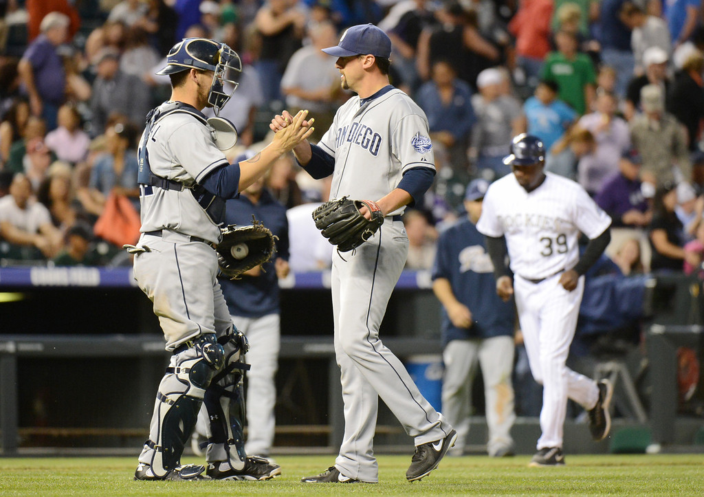 . Denver, CO. - June 08: Yasmani Grandal (12) and Luke Gregerson of San Diego Padres (57) celebrate winning of the game against Colorado Rockies at Coors Field. Denver, Colorado. June 8, 2013. San Diego won 4-2. (Photo By Hyoung Chang/The Denver Post)