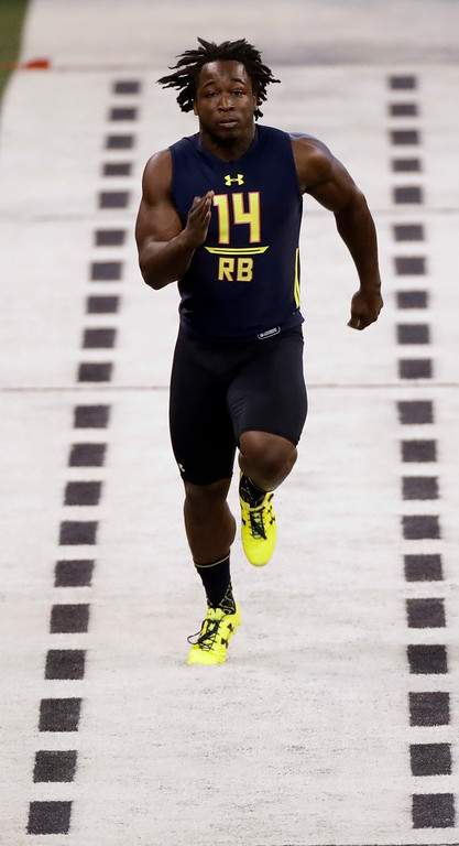 . Toledo running back Kareem Hunt runs the 40-yard dash at the NFL football scouting combine Friday, March 3, 2017, in Indianapolis. (AP Photo/David J. Phillip)