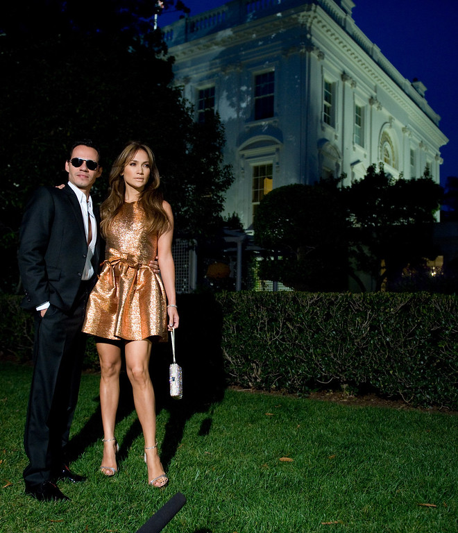 . Marc Anthony and Jennifer Lopez arrive for a taping of �In Performance at the White House: Fiesta Latina,� a concert hosted by US President Barack Obama celebrating Hispanic musical heritage, on the South Lawn of the White House in Washington, DC, on October 13, 2009.  Participants also include Jimmy Smits, Gloria Estefan, George Lopez, Thalía, Tito �El Bambino�, the Bachata music group Aventura, and the Chicano rock band Los Lobos.  (SAUL LOEB/AFP/Getty Images)
